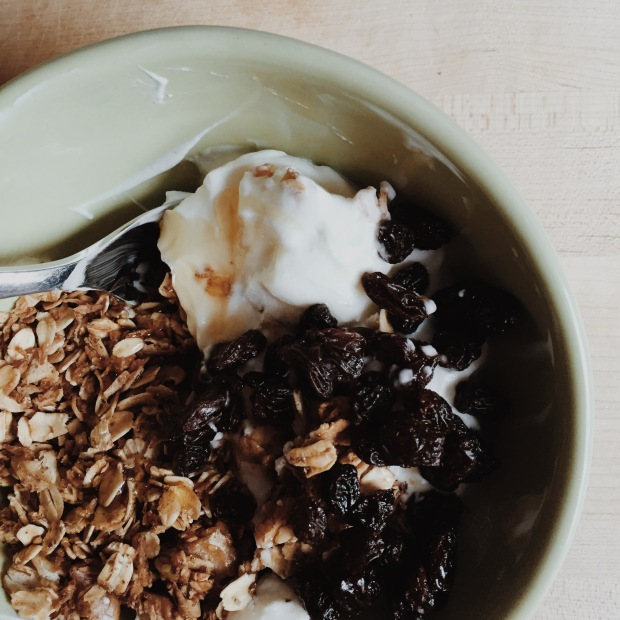 breakfast: granola with yogurt, honey drizzle and raisins.